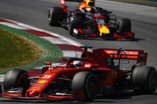 Sebastian Vettel, Ferrari SF90, leads Max Verstappen, Red Bull Racing RB15