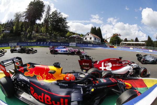 Max Verstappen, Red Bull Racing RB15, makes contact with Kimi Raikkonen, Alfa Romeo Racing C38 at the start