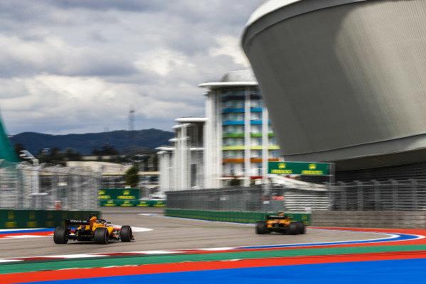 Stoffel Vandoorne, McLaren MCL33, leads Lando Norris, McLaren MCL33