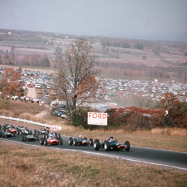 Watkins Glen, New York, USA.4-6 October 1963.Graham Hill (BRM P57) leads team mate Richie Ginther (BRM P57) and John Surtees (Ferrari 156) at the start.Ref-3/1095.World Copyright - LAT Photographic