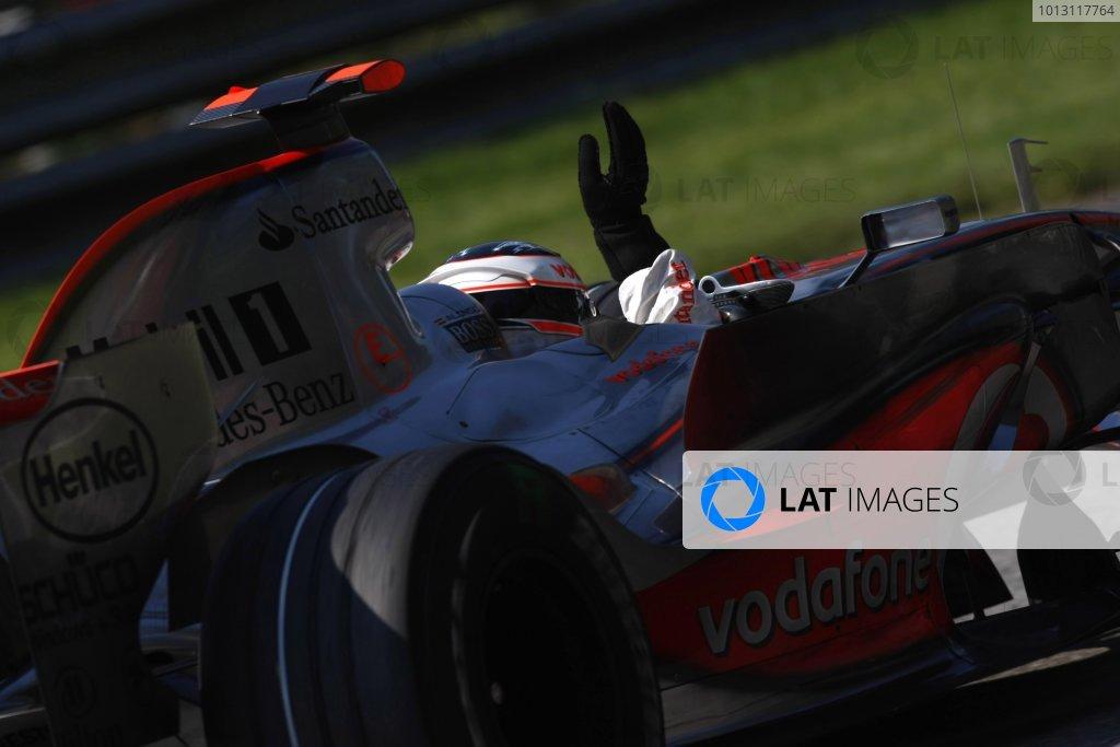 2007 Italian Grand Prix - Sunday RaceAutodromo di Monza, Monza, Italy.9th September 2007.Fernando Alonso, McLaren MP4-22 Mercedes, 1st position, celebrates on his way to Parc Ferme. Action. Finish. World Copyright: Glenn Dunbar/LAT Photographicref: Digital Image _O9T0998