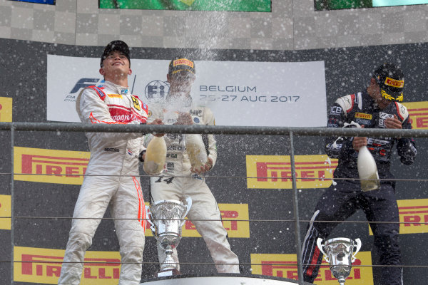 2017 FIA Formula 2 Round 8. Spa-Francorchamps, Spa, Belgium. Sunday 27 August 2017. Sergio Sette Camara (BRA, MP Motorsport) celebrates his victory on the podium with Nyck De Vries (NED, Racing Engineering) and Luca Ghiotto (ITA, RUSSIAN TIME).  Photo: Alastair Staley/FIA Formula 2. ref: Digital Image _L5R6085
