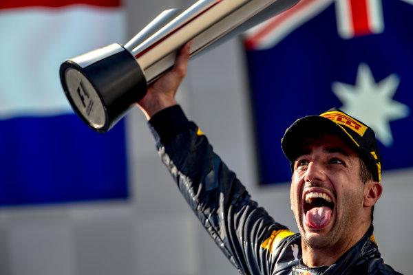 Sepang International Circuit, Sepang, Malaysia. Sunday 2 October 2016. Daniel Ricciardo, Red Bull Racing, 1st Position, celebrates victory on the podium with his trophy. World Copyright: Zak Mauger/LAT Photographic ref: Digital Image _X0W0323