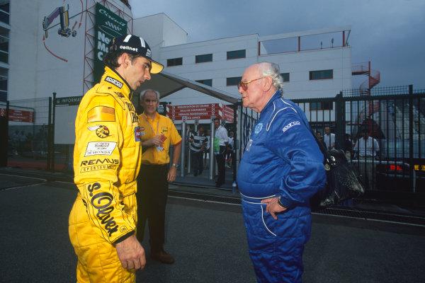 Magny-Cours, France. 25-27 June 1999. Damon Hill (Jordan Mugen Honda) tells Professor Sid Watkins, FIA Medical Delegate, about his retirement decision. portrait. World Copyright: LAT Photographic.Ref: Colour Transparency.