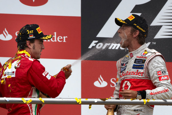 Hockenheimring, Hockenheim, Germany 22nd July 2012 Fernando Alonso, Ferrari, 1st position, and Jenson Button, McLaren, 3rd position, on the podium. World Copyright: Steve Etherington/LAT Photographic ref: Digital Image HC5C5963 copy
