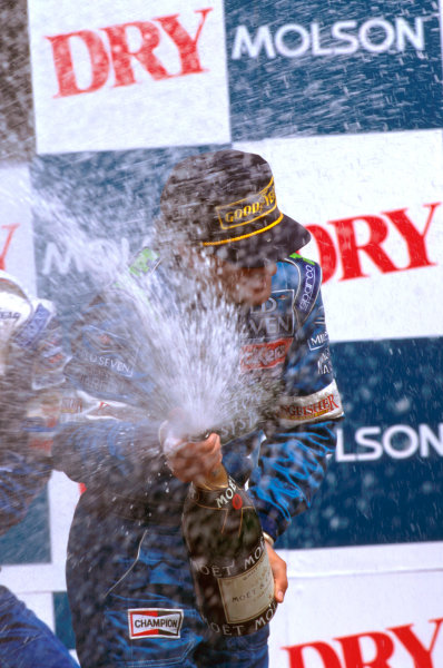 Montreal, Quebec, Canada.14-16 June 1996.Jean Alesi (Benetton Renault) celebrates his 3rd position on the podium.Ref-96 CAN 05.World Copyright - LAT Photographic