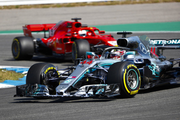 Lewis Hamilton, Mercedes AMG F1 W09, leads Sebastian Vettel, Ferrari SF71H.