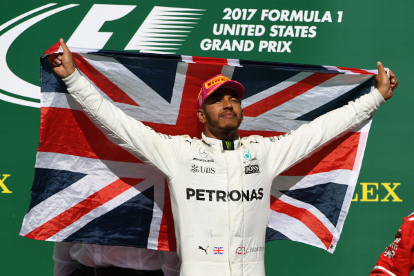 Race winner Lewis Hamilton (GBR) Mercedes AMG F1 celebrates on the podium with the Union flag at Formula One World Championship, Rd17, United States Grand Prix, Race, Circuit of the Americas, Austin, Texas, USA, Sunday 22 October 2017.
