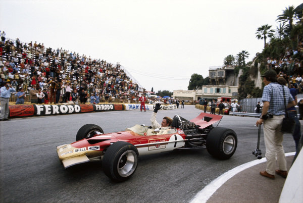 Graham Hill, Lotus 49B Ford, waves to the crowd at Station Hairpin.