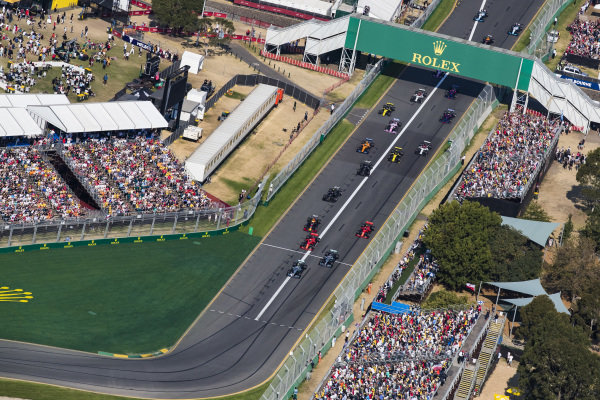 Valtteri Bottas, Mercedes AMG W10, leads Lewis Hamilton, Mercedes AMG F1 W10, Sebastian Vettel, Ferrari SF90, Max Verstappen, Red Bull Racing RB15, Charles Leclerc, Ferrari SF90, and the rest of the field as they head for the first corner