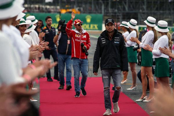 Sergio Perez (MEX) Force India and Sebastian Vettel (GER) Ferrari on the drivers parade at Formula One World Championship, Rd10, British Grand Prix, Race, Silverstone, England, Sunday 16 July 2017.