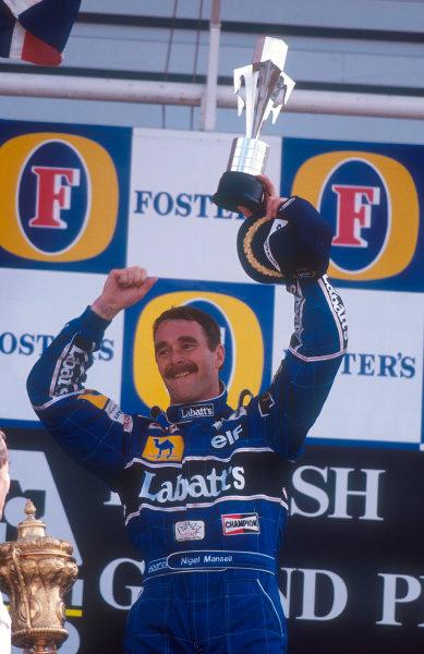 1992 British Grand Prix.Silverstone, England.10-12 July 1992.Nigel Mansell (Williams FW14B Renault) celebrates 1st position on the podium.Ref-92 GB 03.World Copyright - LAT Photographic