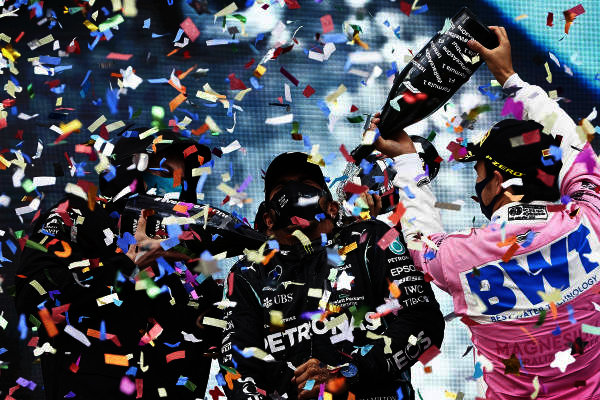 Toto Wolff, Executive Director (Business), Mercedes AMG, Lewis Hamilton, Mercedes-AMG Petronas F1, 1st position, and Sergio Perez, Racing Point, 2nd position, celebrate with champagne on the podium