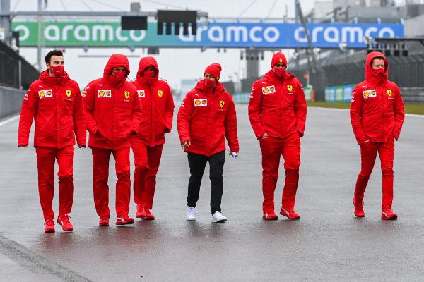 Sebastian Vettel, Ferrari walks the track with members of his Ferrari team