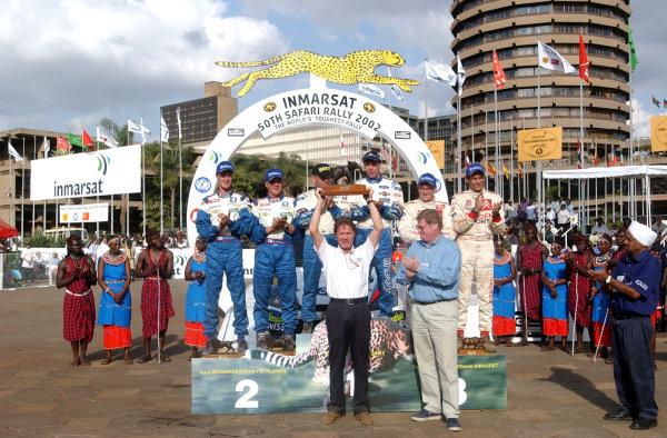 2002 World Rally Championship.Safari Rally, Nairobi Kenya, July 11-14th.Malcolm Wilson receves the manufacturers trophy.Photo: Ralph Hardwick/LAT