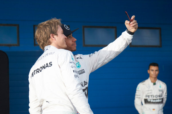 2015 F1 Pre Season Test 1 - Day 1 Circuito de Jerez, Jerez, Spain. Sunday 1 February 2015. Lewis Hamilton, Mercedes AMG, takes a selfie with Nico Rosberg, Mercedes AMG, at the launch of the Mercedes W06. World Copyright: Steve Etherington/LAT Photographic. ref: Digital Image SNE26163