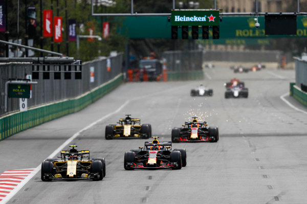 Carlos Sainz Jr., Renault Sport F1 Team R.S. 18, leads Max Verstappen, Red Bull Racing RB14 Tag Heuer, Daniel Ricciardo, Red Bull Racing RB14 Tag Heuer, and Nico Hulkenberg, Renault Sport F1 Team R.S. 18.