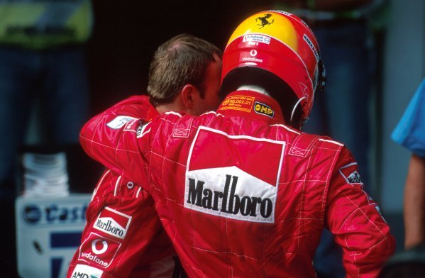 (L-R) Rubens Barrichello (BRA) Ferrari and team mate Michael Schumacher (GER) have a few words in parc ferme following the controversial finish.Formula One World Championship, Rd6, Austrian Grand Prix, A1-Ring, Austria. 12 May 2002.BEST IMAGE