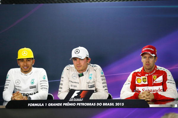 Interlagos, Sao Paulo, Brazil. Sunday 15 November 2015. Nico Rosberg, Mercedes AMG, 1st Position, Lewis Hamilton, Mercedes AMG, 2nd Position, and Sebastian Vettel, Ferrari, 3rd Position, in the Press Conference. World Copyright: Alastair Staley/LAT Photographic ref: Digital Image _R6T6383
