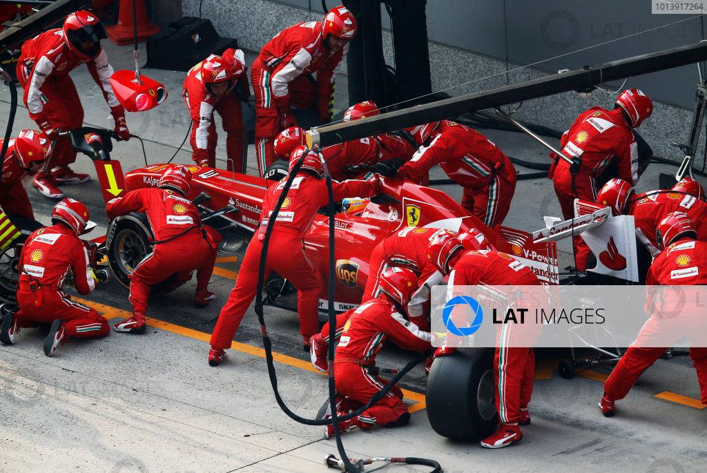 Shanghai International Circuit, Shanghai, China Sunday 14th April 2013 Fernando Alonso, Ferrari F138, in the pits. World Copyright: Steven Tee/LAT Photographic ref: Digital Image _14P7256