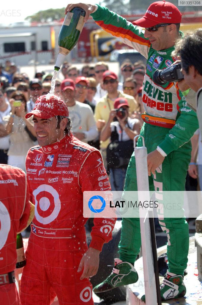 17-19 April, 2009, Long Beach, California, USA Dario Franchitti receives a champagne shower from Tony Kanaan©2009, Phil Sedgwick, USA LAT Photographic