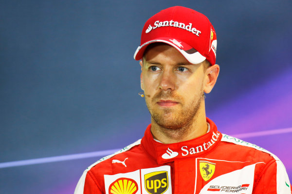 Marina Bay Circuit, Singapore. Saturday 19 September 2015. Pole man Sebastian Vettel, Ferrari, in the post Qualifying Press Conference. World Copyright: Alastair Staley/LAT Photographic. ref: Digital Image _79P2312