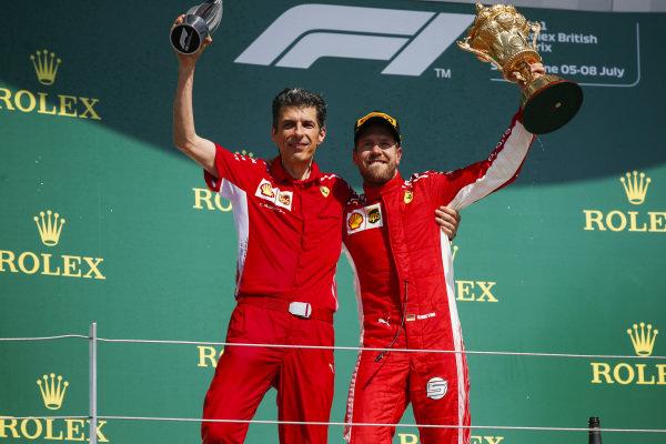 Claudio Albertini, Ferrari, and Sebastian Vettel, Ferrari, 1st position, on the podium with their trophies.