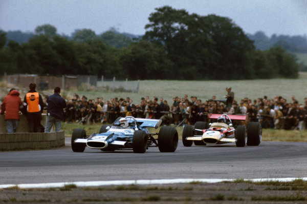 Silverstone, Great Britain. 19 July 1969.Jackie Stewart, Matra MS80-Ford, 1st position, leads Jochen Rindt, Lotus 49B-Ford, 4th position, action.World Copyright: LAT PhotographicRef: 69 GB 36
