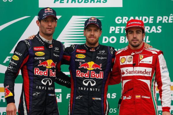 Interlagos, Sao Paulo, Brazil. Sunday 24th November 2013.  Sebastian Vettel, Red Bull Racing, Mark Webber, Red Bull Racing, and Fernando Alonso, Ferrari celebrate the top three positions on the podium. World Copyright: Andrew Ferraro/LAT Photographic. ref: Digital Image _79P8919