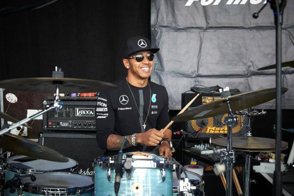 Red Bull Ring, Spielberg, Austria. Saturday 20 June 2015. Lewis Hamilton, Mercedes AMG, tries his hand at drumming. World Copyright: Steve Etherington/LAT Photographic. ref: Digital Image SNE24050