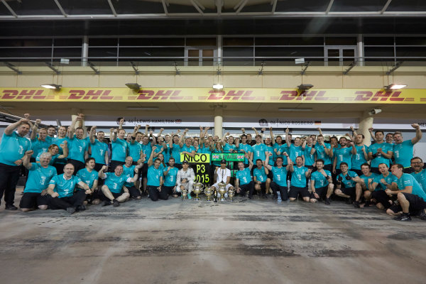 Bahrain International Circuit, Sakhir, Bahrain. Sunday 19 April 2015. Lewis Hamilton, Mercedes AMG, 1st Position, Nico Rosberg, Mercedes AMG, 3rd Position, and the Mercedes team celebrate victory. World Copyright: Steve Etherington/LAT Photographic. ref: Digital Image SNE24565