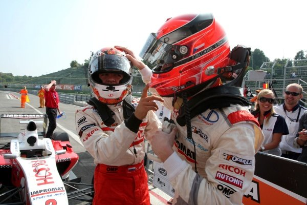 Second placed Josef Kral (CZE), right, congratulates JD Motorsport team mate Sergey Afanasiev (RUS), left, who finished third.