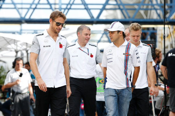 Interlagos, Sao Paulo, Brazil. Friday 7 November 2014. Jenson Button, McLaren, adn Felipe Massa, Williams F1, with Kevin Magnussen, McLaren, in the background. World Copyright: Charles Coates/LAT Photographic. ref: Digital Image _J5R3171
