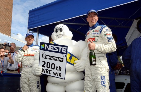 Michelin celebrate their 200th WRC win with Neste Rally Finland winners Markko Martin (EST), right, and co-driver Michael Park (GBR), left, Ford.