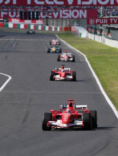 2006 Japanese Grand Prix - Sunday Race,  Suzuka, Japan. Michael Schumacher and Felipe Massa, Ferrari 248 F1; action. 8th October 2006  World Copyright: Steve Etherington/LAT Photographic  ref: 48mb Hi Res Digital Image Only