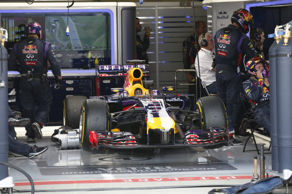 Red Bull Ring, Spielberg, Austria. Sunday 22 June 2014. The retired car of Sebastian Vettel, Red Bull Racing RB10 Renault, in the garage. World Copyright: Alastair Staley/LAT Photographic. ref: Digital Image _79P7616
