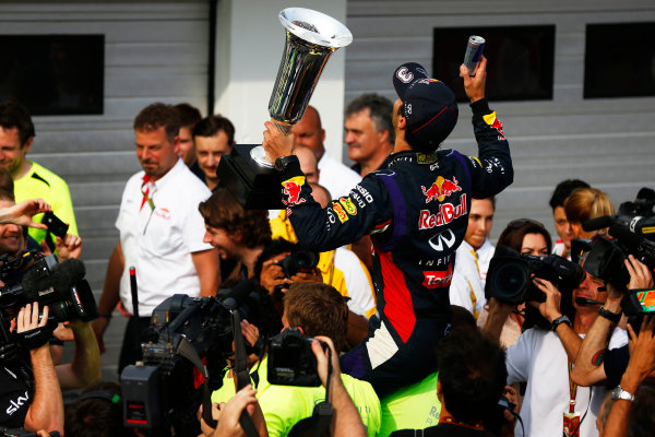 Hungaroring, Budapest, Hungary. Sunday 27 July 2014. Daniel Ricciardo, Red Bull Racing, 1st Position, and the Red Bull team celebrate victory. World Copyright: Andy Hone/LAT Photographic. ref: Digital Image _ONY2932