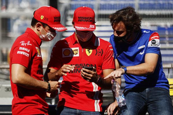 Charles Leclerc, Ferrari, Carlos Sainz, Ferrari, and Fernando Alonso, Alpine F1