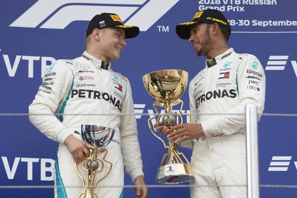 Lewis Hamilton, Mercedes AMG F1 and Valtteri Bottas, Mercedes AMG F1, with their trophies on the podium