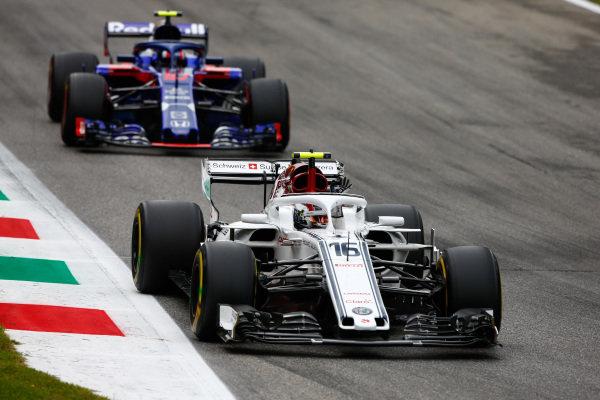 Charles Leclerc, Sauber C37 Ferrari, leads Pierre Gasly, Toro Rosso STR13 Honda.