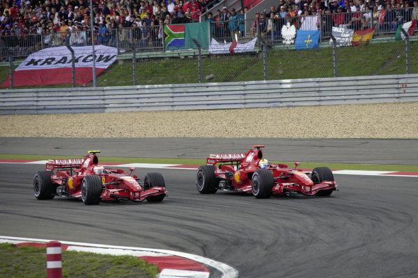 Felipe Massa, Ferrari F2007 attacks around the outside of Kimi Räikkönen, Ferrari F2007.