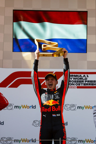 Max Verstappen, Red Bull Racing, 1st position, celebrates on the podium with his trophy