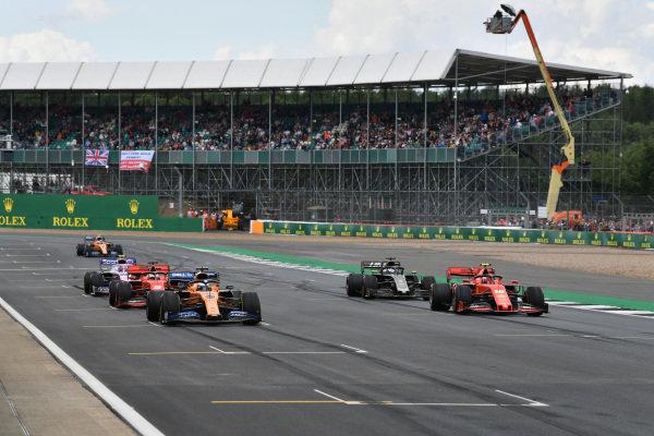 Carlos Sainz Jr., McLaren MCL34, Charles Leclerc, Ferrari SF90, Romain Grosjean, Haas VF-19, Sebastian Vettel, Ferrari SF90, Lance Stroll, Racing Point RP19, and Lando Norris, McLaren MCL34, practice starts at the end of the session