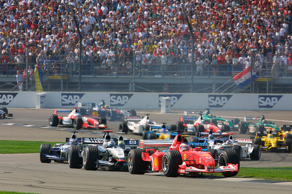 2002 American Grand Prix.Indianapolis, Indiana, USA. 27-29 September 2002.Rubens Barrichello (Ferrari F2002) followed by David Coulthard (McLaren MP4/17 Mercedes), Juan-Pablo Montoya (Williams FW24 BMW) and the rest of the field at the start.World Copyright - LAT Photographicref: Digital File Only