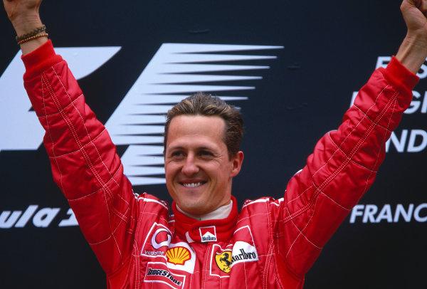 2002 Belgian Grand Prix.Spa-Francorchamps, Belgium. 30/8-1/9 2002.Michael Schumacher (Ferrari) celebrates his 1st position and record 10th Grand Prix win in a single season, on the podium. Ref-02 BEL 23.World Copyright - Rose/LAT Photographic