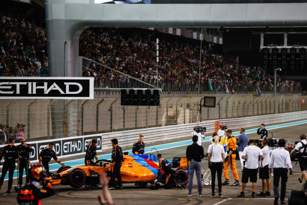 McLaren mechanics collect the car of Fernando Alonso, McLaren MCL33, as he celebrates after his final race in F1