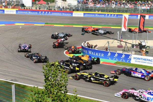 Kimi Raikkonen, Alfa Romeo Racing C38, is knocked into the air by Max Verstappen, Red Bull Racing RB15. Charles Leclerc, Ferrari SF90, leads the field from Lewis Hamilton, Mercedes AMG F1 W10, Sebastian Vettel, Ferrari SF90 and Valtteri Bottas, Mercedes AMG W10