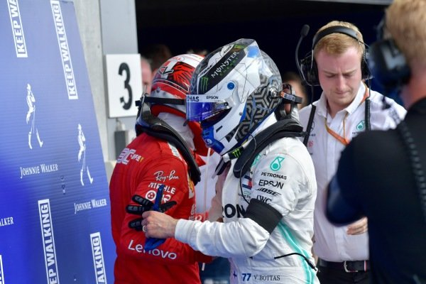 Charles Leclerc, Ferrari, 1st position, is congratulated by Valtteri Bottas, Mercedes AMG F1, 3rd position, in Parc Ferme