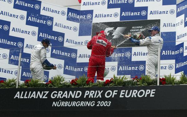 2003 European Grand Prix - Sunday Race,Nurburgring, Germany. 29th June 2003 Race podium, Ralf Schumacher, BMW Williams FW25, (1st) Juan-Pablo Montoya, (2nd) and Rubens Barrichello, Ferrari F2003 GA, (3rd).World Copyright: Steve Etherington/LAT Photographic ref: Digital Image Only