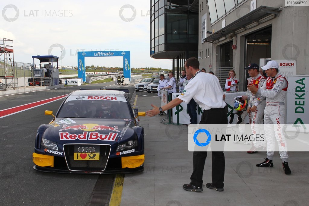 Congratulations for pole man Miguel Molina (ESP), Audi Sport Team Abt Junior, Red Bull Audi A4 DTM (2008) from his team mates Mattias Ekstrom (SWE), Audi Sport Team Abt Sportsline, Red Bull Audi A4 DTM (2009) and Oliver Jarvis (GBR), Audi Sport Team Abt, Audi Performance A4 DTM (2009).DTM, Rd8, Oschersleben, Germany, 16-18 September 2011 Ref: Digital Image dne1117se503
